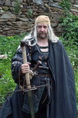 Man in the Gothic costume with big sword — Stock Photo