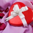 Red Rose and Heart-shaped Gift Box with - Stock Photo