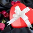 Stock Photo: Red Rose and Heart-shaped Gift Box with