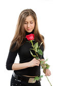 Beautiful girl in love holding a red rose isolated over a white background — Stock Photo