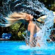 The woman comes up from pool — Stock Photo