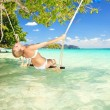 Stock Photo: Woman on a swing