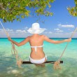 Woman on a swing - Foto Stock