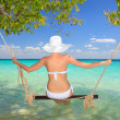 Woman on a swing - Stockfoto