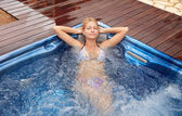 Woman relaxing in jacuzzi — Stock Photo