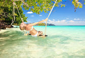 Woman on a swing — Stock Photo