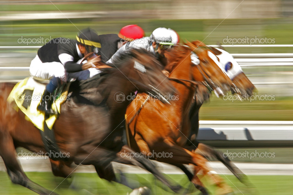 Slow shutter speed rendering of a group of racing horses and riders — Stock Photo #2487607
