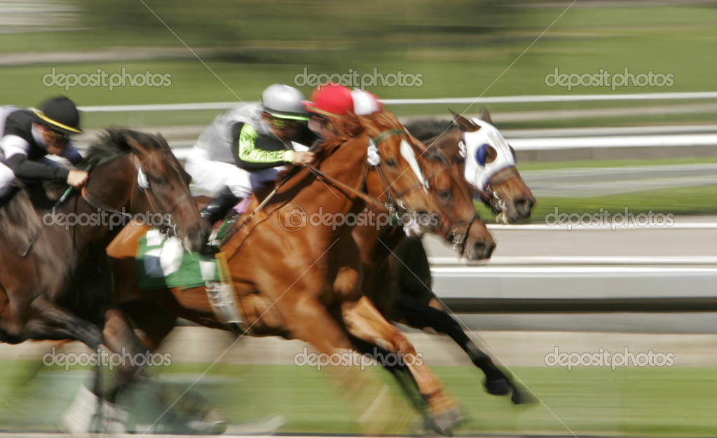 Slow shutter speed rendering of racing jockeys and horses — Stock Photo #2487608