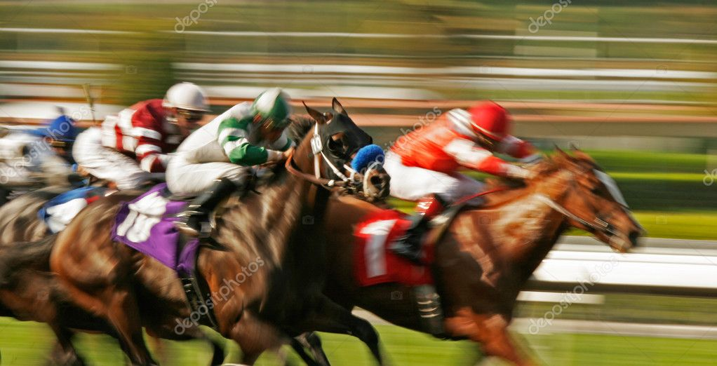 Slow shutter speed rendering of horses and jockeys storming down the homestretch. — Foto Stock #2520637