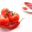 Red tomato and peper with ketchup — Stock Photo