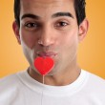 Amorous man kissing love heart — Stock Photo