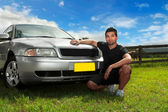 Man beside car in afternoon sun — Stock Photo