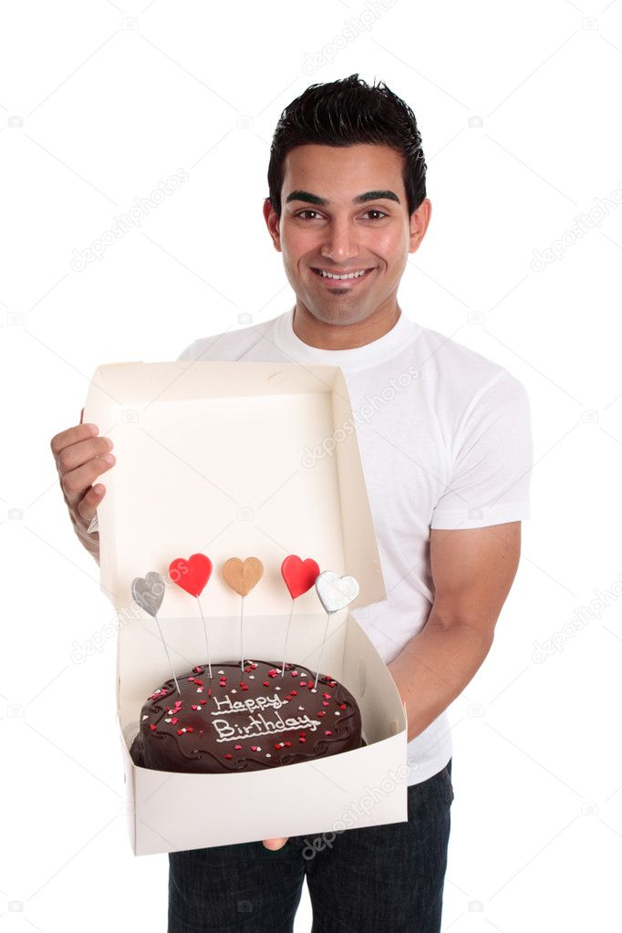 A smiling man holds a chocolate birthday cake decorated with love hearts in a cake box   Stock Photo #2463650