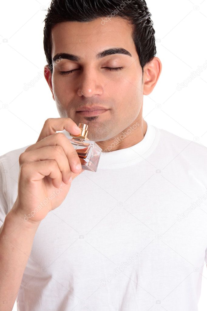 A guy or customer holds a bottle of perfume cologne to smell its fragrance scent. — Stock Photo #2463693