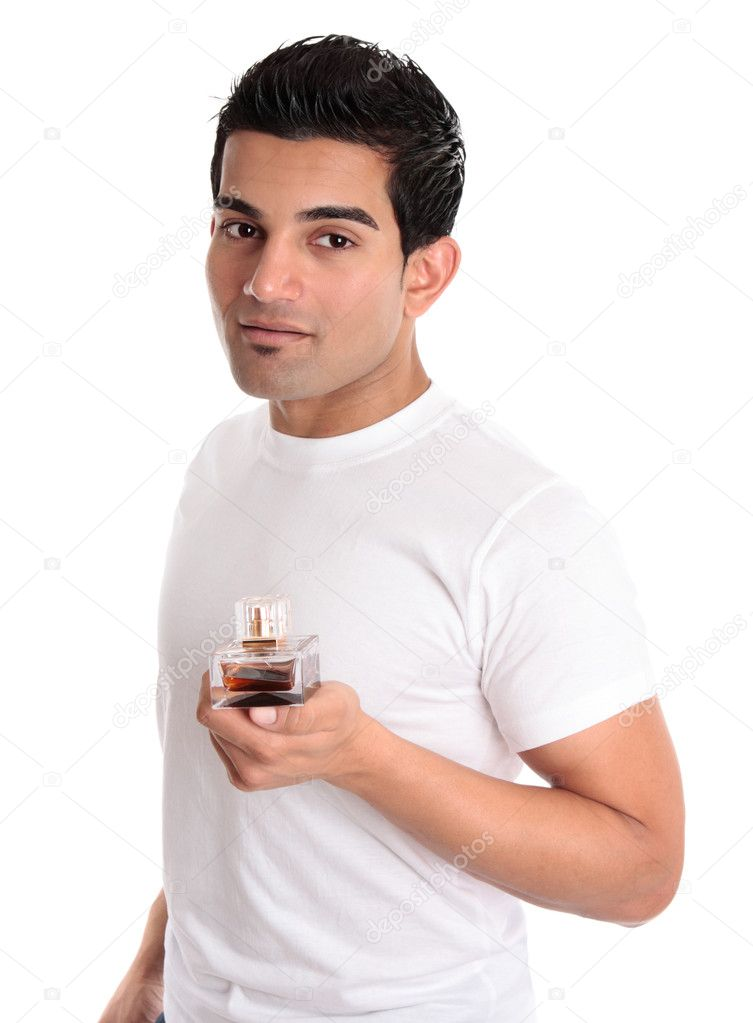 A man holds a bottle of cologne, aftershave or men's fragrance in his hand — Stock Photo #2463699