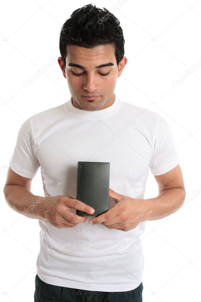A man looking down at a boxed product or merchandise that he is holding in his hands. — Stock Photo #2463710