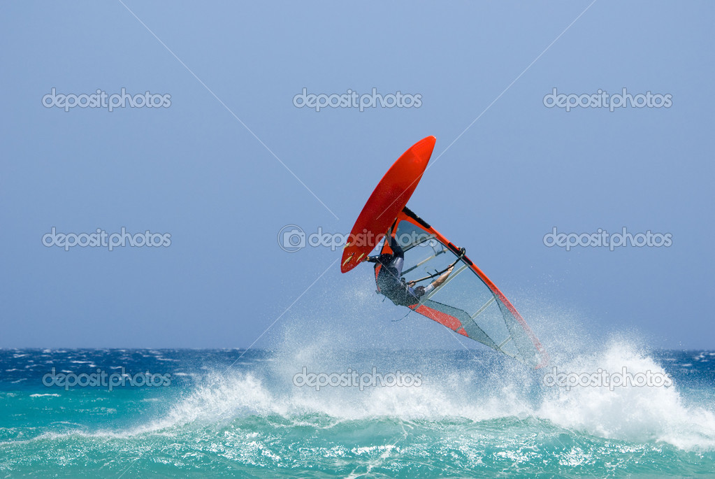 An acrobatic surfer in a wild ocean — Stock Photo #2418498