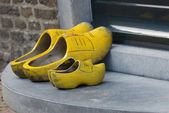 Two pair of wooden shoes — Stock Photo