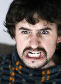 Close up of angry young man — Stock Photo