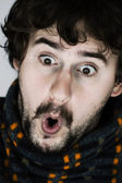 Close up portrait of surprised young man — Stock Photo