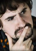 Portrait of thoughtful young man — Stock Photo