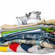 Stock Photo: Pile of boys clothes isolated on white