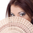 Girl look over fan fanteil — Stock Photo