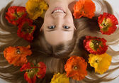 Flower around innocent girl — Stock Photo