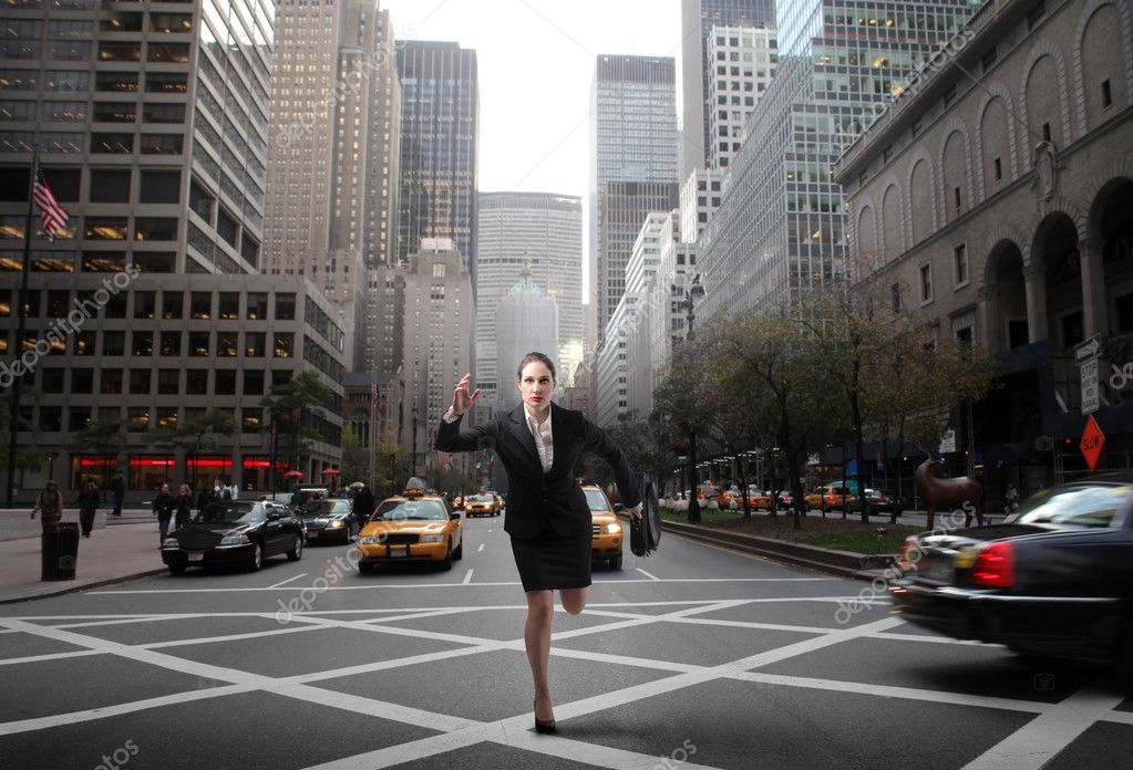 Portrait of a businesswoman running on a city street — Stock Photo #2488274