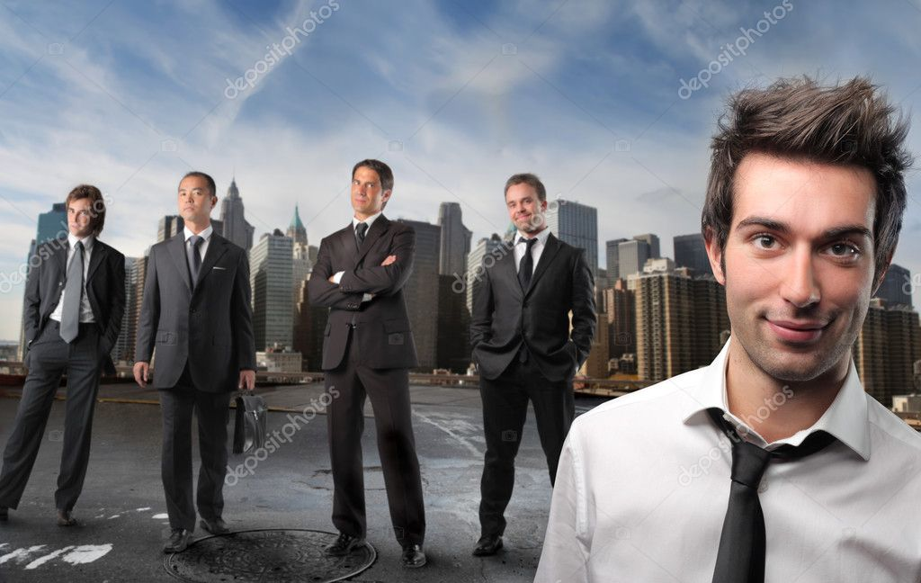 Portrait of a group of businessmen with cityscape on the background — Stock Photo #2489454