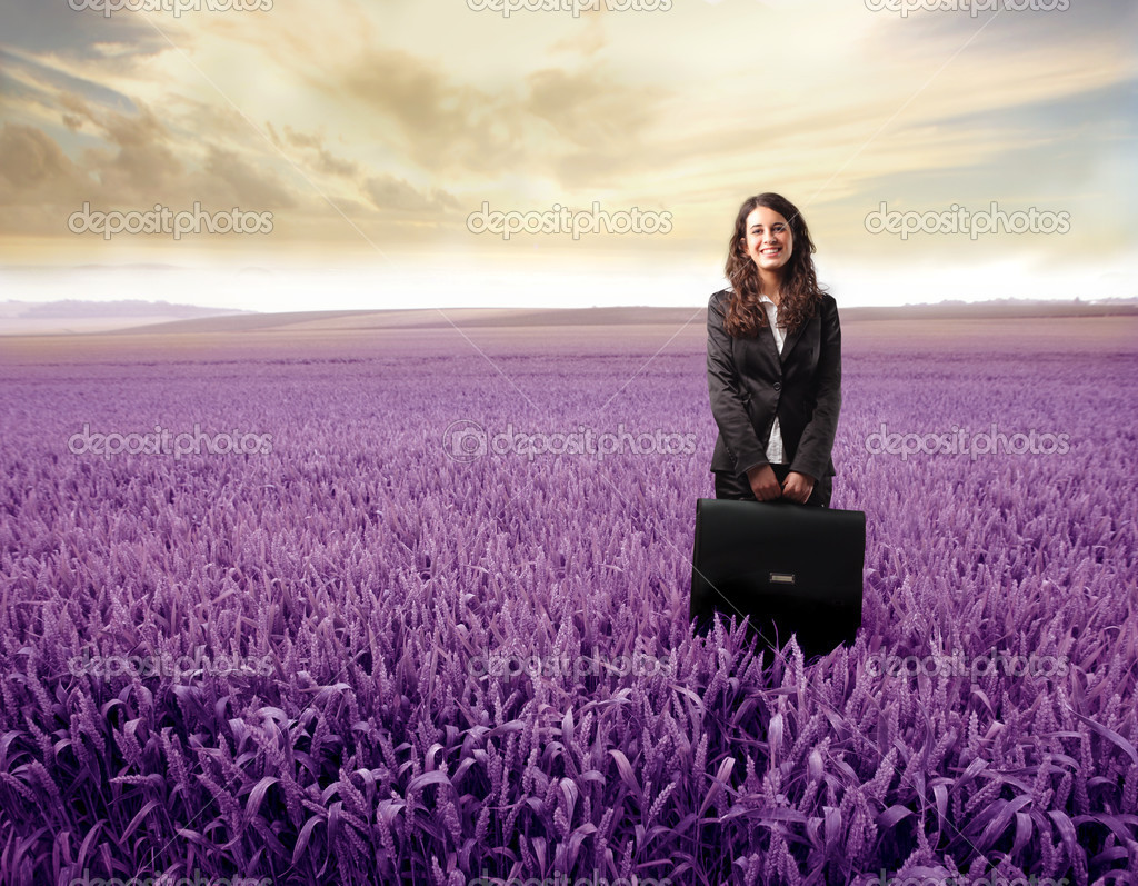 Smiling young businesswoman standing on a lavender meadow  Stock Photo #2505402