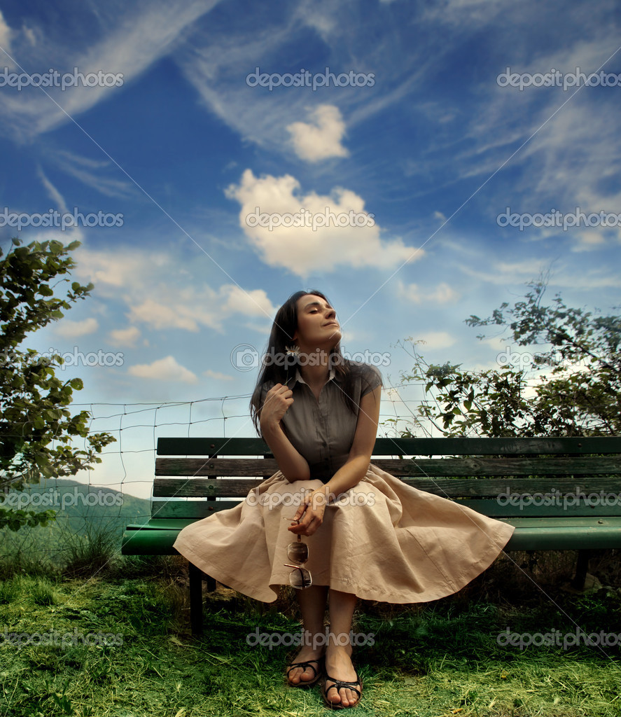 Woman sitting on a park bench  — Stock Photo #2518700