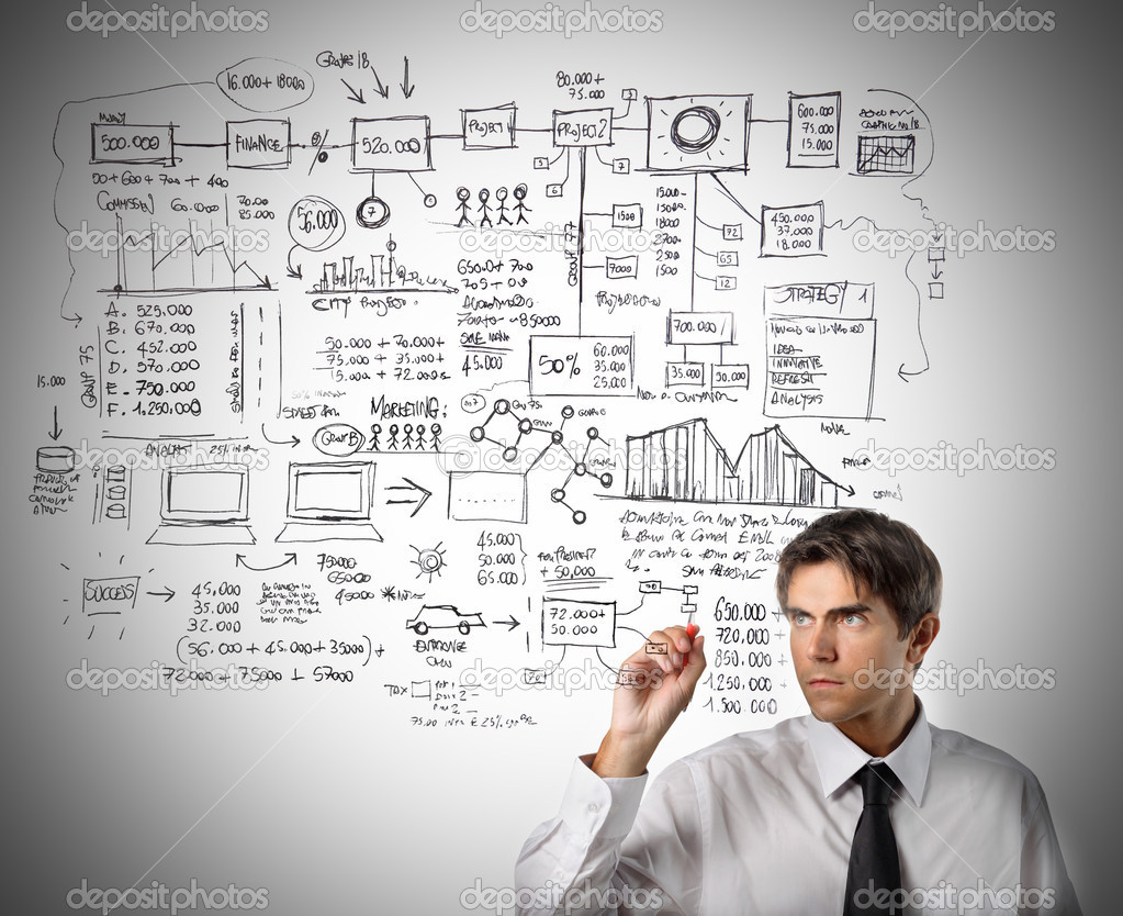 Young businessman creating a graph — Stock Photo #2518984