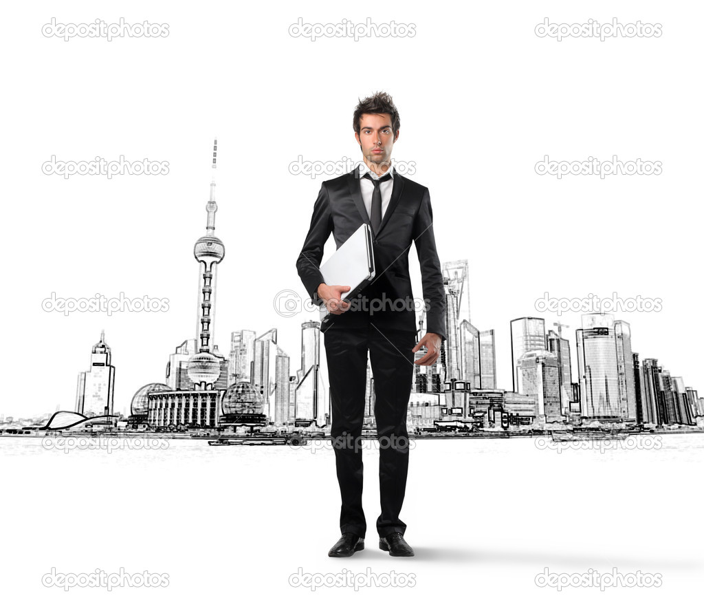 Young businessman with image of a city on the background  — Stock Photo #2519528