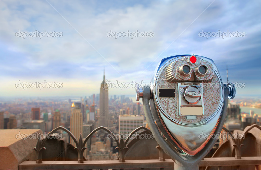View of a telescope on the top of a skyscraper looking over a city — Stock Photo #2519619