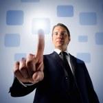 człowiek biznesu, naciskając przycisk dotykowy — Zdjęcie stockowe