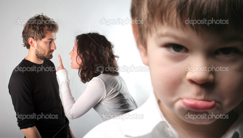 Young couple quarreling and closeup to a sad child — Stock Photo #2537808