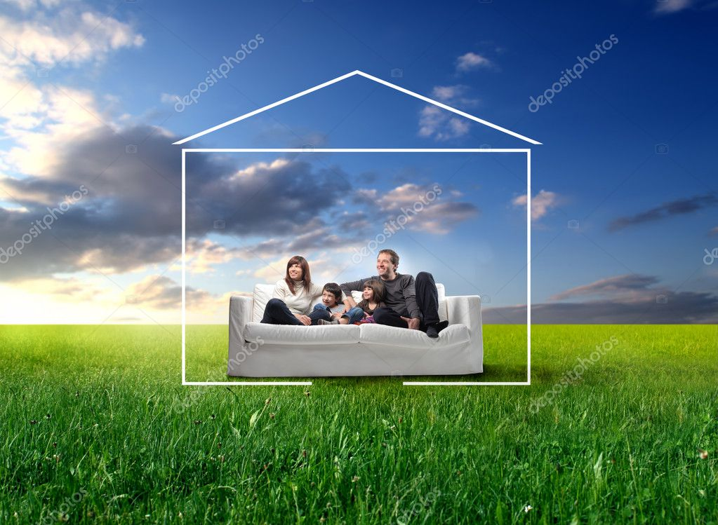 Smiling family sitting on a sofa on a green meadow surrounded by the form of a house — Foto Stock #2537822