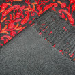 Black cashmere shawl with red embroidery — Stock Photo