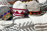 Handmade woolen hats and sweaters — Stock Photo