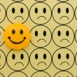Yellow smiley against sad emoticon — Stock Photo #2463610
