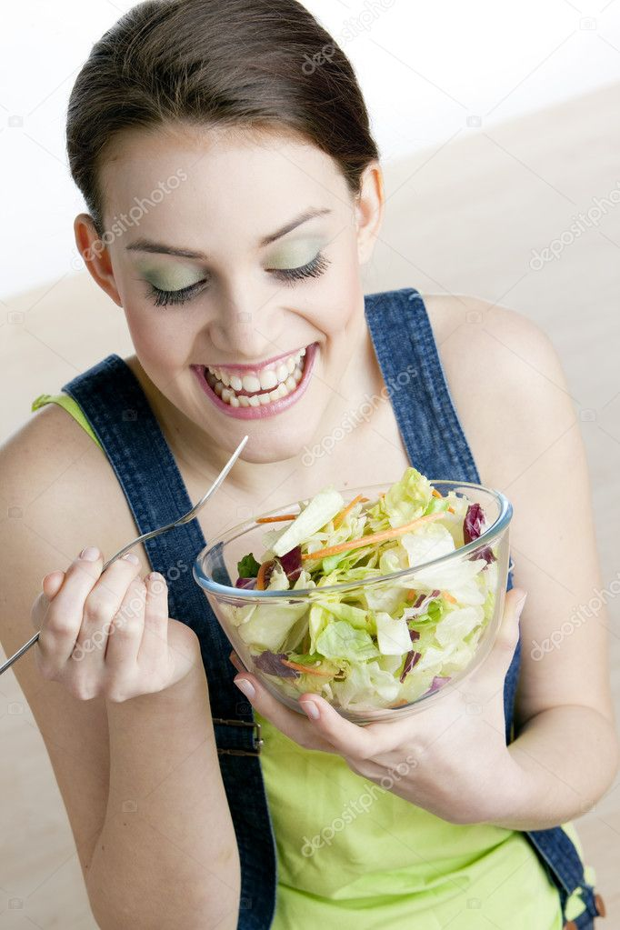 Portrait of woman eating salad  Stock Photo #2516623