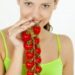 Woman holding tomatoes — Stock Photo