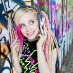 Woman at graffitti wall — Stock Photo