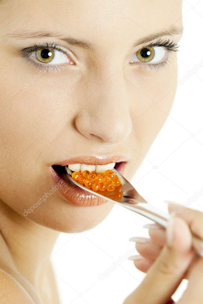 Portrait of woman with red caviar  Stock Photo #2554504