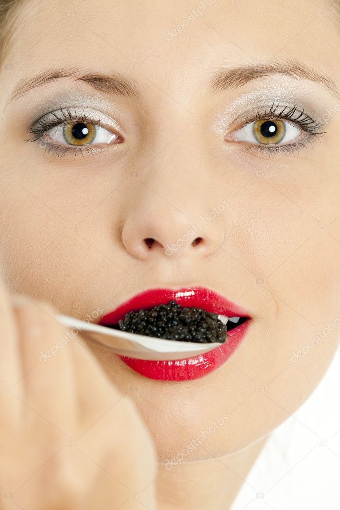 Portrait of woman with black caviar — Stock Photo #2554514