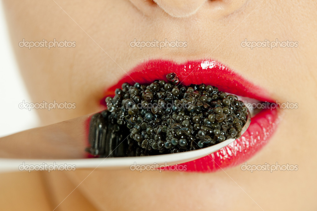 Detail of woman with black caviar — Stock Photo #2554521