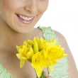 Woman with daffodils — Stock Photo #2600468