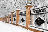 Snowcovered fence — Stock Photo
