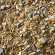 Background with stones on yellow clay — Stock Photo